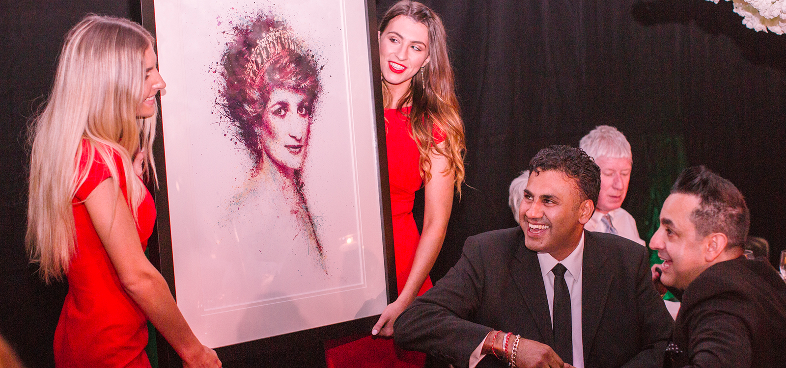 Carita team holding a portrait of Princess Diana.